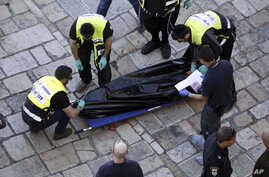 Israeli emergency services remove the body of an alleged Palestinian attacker in Jerusalem Friday, Feb. 19, 2016. The Palestinian stabbed two officers before he was shot and killed, police said.