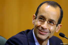 FILE - Marcelo Odebrecht, then the head of Latin America's largest engineering and construction company Odebrecht SA, smiles as he gives his testimony in a session of the Parliamentary Committee of Inquiry in Curitiba, Brazil, September 1, 2015.