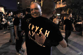 Extreme far-right Golden Dawn party's supporters celebrate and has vowed to kick out immigrants and mine Greece's borders with Turkey
