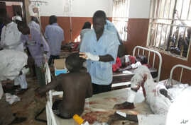 People are treated at the General hospital in Potiskum, Nigeria, Monday, Nov. 10, 2014, following a suicide bomb attack at Government Science Technical College Potiskum. Survivors say a suicide bomber disguised in a school uniform has detonated explo...