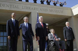 President Barack Obama, from left, and four former presidents, George W. Bush, Bill Clinton, George H.W. Bush and Jimmy Carter appear together at a dedication ceremony in Dallas, Texas.
