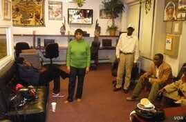 Inside the Malian Association of New York, expats meet regularly to gather news of their conflict-ridden homeland and to share emotional support. (A. Phillips/VOA)