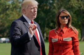 President Donald Trump, accompanied by first lady Melania Trump, stops to answers reporters' questions, on at South Lawn of the White House in Washington, Sept. 10, 2017.