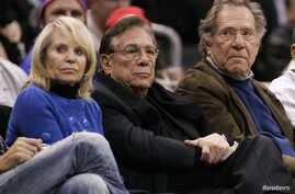 FILE - Los Angeles Clippers owner Donald Sterling (C), his wife Shelly (L) and actor George Segal attend the NBA basketball game between the Toronto Raptors and the Los Angeles Clippers at the Staples Center in Los Angeles.