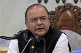 FILE - India's Finance and Defense Minister Arun Jaitley speaks during a news conference in Srinagar, India, June 2014.