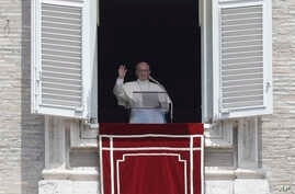 Pope Francis delivers his blessing during the Angelus prayer in St. Peter's Square, at the Vatican, July 2, 2017.