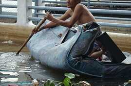 Despite Floods, Thai Central Banker Remains Upbeat on Recovery
