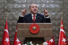 Turkey's President and leader of ruling Justice and Development Party Recep Tayyip Erdogan speaks to village administrators in Ankara, Turkey, Thursday, Jan. 11, 2018.