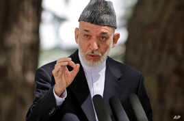 Afghan President Hamid Karzai speaks during a press conference at the presidential palace in Kabul, Aug, 24, 2013.
