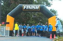 The Ahmadiyya Muslim Youth Association hosted a 5K run/walk to raise money for a local food bank and an international charity in Washington, D.C., Oct. 1, 2016. Most of the runners were dressed in long black sweatpants topped with blue T-shirts. A fe...