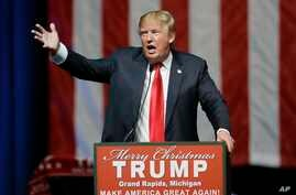 Republican presidential candidate, businessman Donald Trump addresses supporters at a campaign rally, Dec. 21, 2015, in Grand Rapids, Mich.