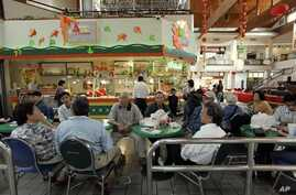 A group of Vietnamese Americans eat lunch at the Asian Garden mall in the Little Saigon section of Westminster Calif in this Associated Press file photo.