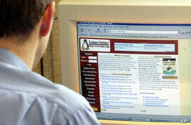 FILE - An employee in the city hall in Munich is watching the webpage of the Linux operating system in Munich, southern Germany, on Tuesday, June 15, 2004.