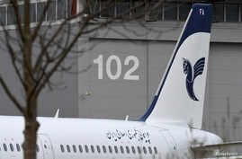"An Airbus A321 with the description ""The Airline of the Islamic Republic of Iran"" below the tail fin is parked at the Airbus facility in Hamburg Finkenwerder, Germany, Dec. 19, 2016."