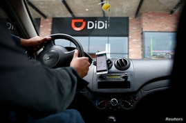 A new driver's mobile phone is seen with the app of Chinese ride-hailing firm, outside the new drivers center in Toluca, Mexico, April 23, 2018.