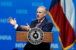 FILE - Governor Greg Abbott speaks at the National Rifle Association-Institute for Legislative Action Leadership Forum in Dallas, May 4, 2018.