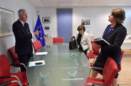 FILE - European Union's chief Brexit negotiator Michel Barnier attends a meeting with Northern Ireland's Democratic Unionist Party (DUP) leader Arlene Foster and DUP member Diane Dodds at the EU Commission headquarters in Brussels, Belgium, Oct. 9, 2