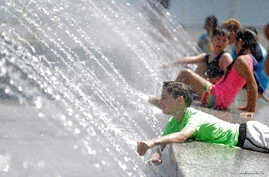 Children play in a fountain during a heat wave in Washington, July 24, 2016.