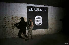 FILE - An Iraqi soldier inspects a former train tunnel displaying the the Islamic State group flag, in western Mosul, Iraq, March 1, 2017. The tunnel once served as a training camp for IS fighters.