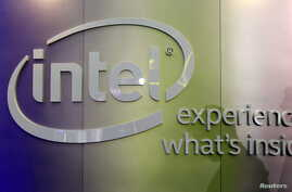 FILE - Shadows are cast near an Intel logo at the Intel booth during the 2015 Computex exhibition at the TWTC Nangang exhibition hall in Taipei, Taiwan, June 2, 2015.