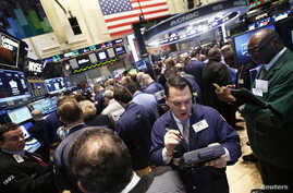 FILE - Traders work during the IPO of Mobile game maker King Digital Entertainment Plc on the floor of the New York Stock Exchange, March 26, 2014.