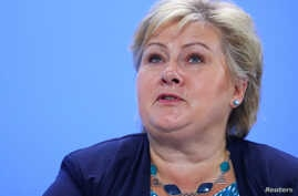 FILE - Norway's Prime Minister Erna Solberg attends the press conference after the meeting at the Chancellery in Berlin, Germany, June 29, 2017.