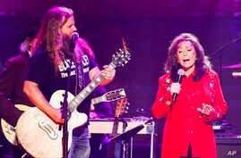 "Jamey Johnson (left) and Loretta Lynn perform at the concert ""Sing me Back Home: The Music of Merle Haggard"" at the Bridgestone Arena, April 6, 2017, in Nashville, Tenn."
