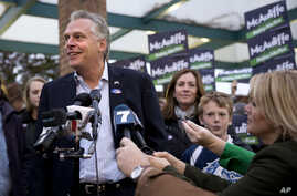 Virginia Democratic gubernatorial candidate Terry McAuliffe answers questions from the media after voting on election day in McLean, Va. on Tuesday, Nov. 5, 2013.