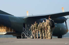 German weapons instructors, heading for Kurdistan board a Transall transport aircraft at the NATO airfield in Hohn, Germany, Sept. 19, 2014.