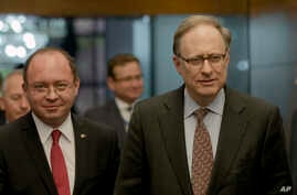 FILE - Romanian Foreign Minister Bogdan Aurescu, left, walks with NATO Deputy Secretary-General Alexander Vershbow in Bucharest, Romania, Oct. 15, 2015.