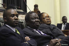 Zimbabwe Vice President Joice Mujuru (R), Prime Minister Morgan Tsvangirai (C) and member of the House of Assembly of Zimbabwe for Kuwadzana, Nelson Chamisa, attend the presentation of the Final Draft of the Constitution for debate in Parliament Buil