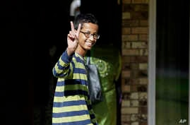 Ahmed Mohamed, 14, gestures as he arrives to his family's home in Irving, Texas, Sept. 17, 2015.
