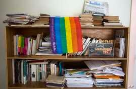 An LGBT pride flag hangs on a bookshelf by a Massimadi festival poster, right, at the the Kouraj organization office in Port-au-Prince, Haiti, Sept. 27, 2016. The four-day Massimadi film, art and performance event was canceled because of threats of v