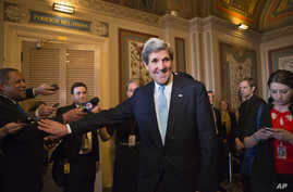 Sen. John Kerry, D-Mass., emerges after a unanimous vote by the Senate Foreign Relations Committee approving him to become America's next top diplomat, replacing Secretary of State Hillary Rodham Clinton, on Capitol Hill in Washington, January 29, 20