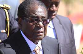FILE - Zimbabwean President, Robert Mugabe, attends the burial of Major General Bandama who died after a short illness at the National Heroes acre in Harare, July, 17, 2014.