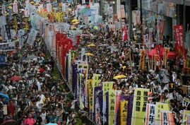 Hundreds of protesters march during an annual pro-democracy protest in Hong Kong, Friday, July 1, 2016
