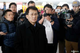 North Korean diplomat Choe Kang Il, center, waits at Capital International Airport to check in to a flight to Helsinki in Beijing, March 18, 2018.