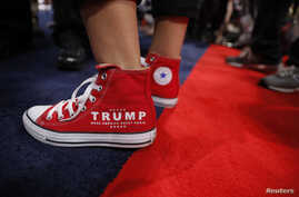 FILE - A supporter of Donald Trump wears a slogan on his sneakers as he attends opening of the Republican National Convention in Cleveland, Ohio, U.S., July 18, 2016.