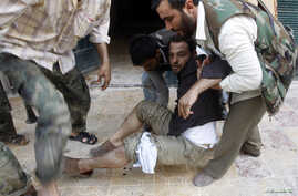 A Free Syrian Army fighter is wounded during a fight with forces loyal to President Bashar Al-Assad in downtown Aleppo, August 1, 2012.
