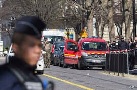 French police officers take position after letter bomb exploded at the French office of the International Monetary Fund, lightly injuring one person, March 16, 2017.