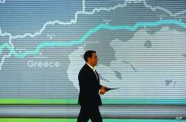 Greece's Prime Minister Alexis Tsipras goes to the podium to deliver a speech during the Trans Adriatic Pipeline inauguration ceremony, in the northern Greek city of Thessaloniki, May 17, 2016.