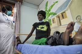 Newly-diagnosed HIV-positive woman receives treatment at the Mildmay Uganda clinic, Kampala, Feb. 27, 2014.