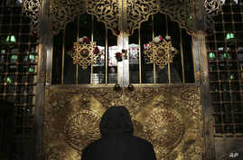 A man prays a day before Moulid, which commemorates the birth of Prophet Muhammad, the central figure of the Islamic religion, at a mosque in Cairo, Egypt, Jan. 2, 2015.