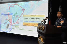 FILE - Air Force Lieutenant General Liu Shou-Jen introduces a map of Air Defense Identification Zone (ADIZ) in the East China Sea during a press conference in Taipei, Taiwan, Dec. 2, 2013. Taiwan said its military planes have made about 30 flights in