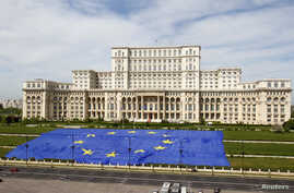 FILE - A large European Union flag is displayed in front of Romania's Parliament Building to mark EU Day in Bucharest, May 9, 2013.