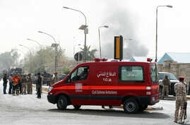 An ambulance arrives at the scene of a bomb attack in Baghdad, March 14, 2013.