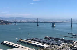 A wide shot of the San Francisco-Oakland Bay Bridge as sail boats and ferries make their way across the bay in San Francisco, California, Monday, Sept 10, 2018. (Courtesy: Yasmine Bekheet)