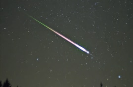 A meteor of the Leonid meteor shower. The photograph shows the meteor, afterglow, and wake as distinct components.
