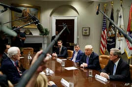 "President Donald Trump speaks during a roundtable on the ""Foreign Investment Risk Review Modernization Act"" in the Roosevelt Room of the White House, Aug. 23, 2018, in Washington."