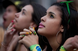 Fans watch a live telecast of the Mexico vs. Brazil match at the FIFA Fan Fest during the 2014 soccer World Cup in Sao Paulo, Brazil, June 17, 2014.